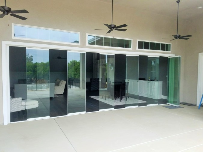 Frameless Exterior doors, folding patio Doors, bifold doors , la Cantina Doors, frameless glass wall