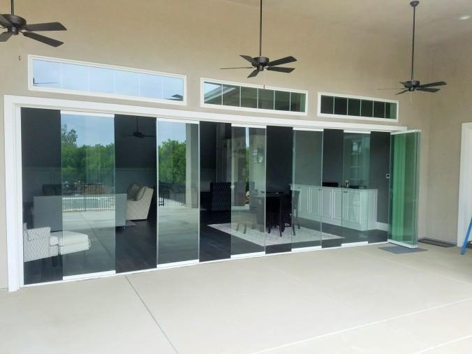 Frameless Exterior doors, folding patio Doors, bifold doors , la Cantina Doors, frameless glass wall