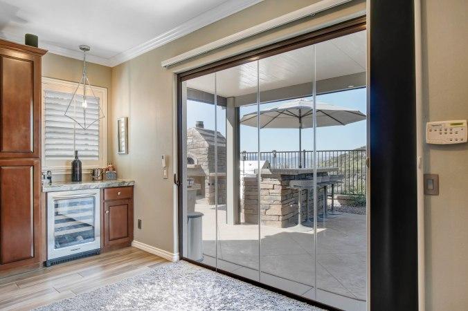 folding patio doors, bifold doors, exterior folding doors, frameless folding glass wall