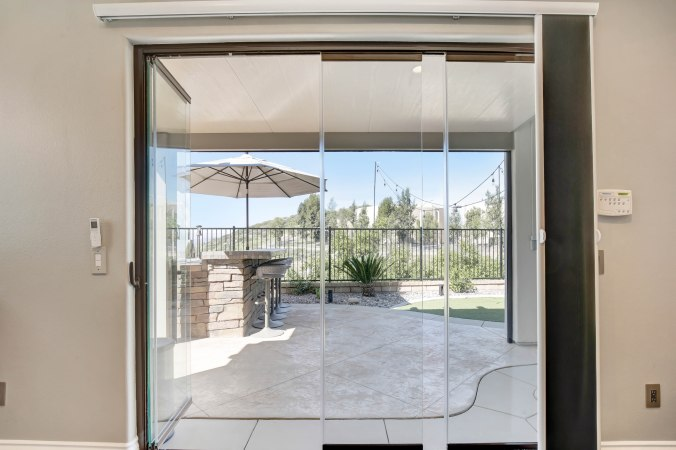 Folding Glass Wall, NanaWall alternative, La Cantina Doors, Frameless Folding Doors. Exterior Folding glass wall
